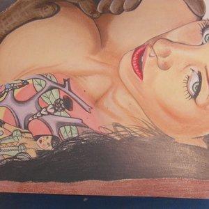 mujer_con_tatuajes_en_el_brazo_39659.jpg
