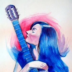Mujer y guitarra