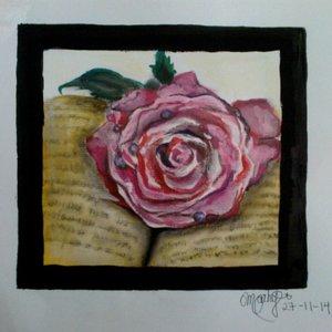 rosa_sobre_libro_88940.jpeg