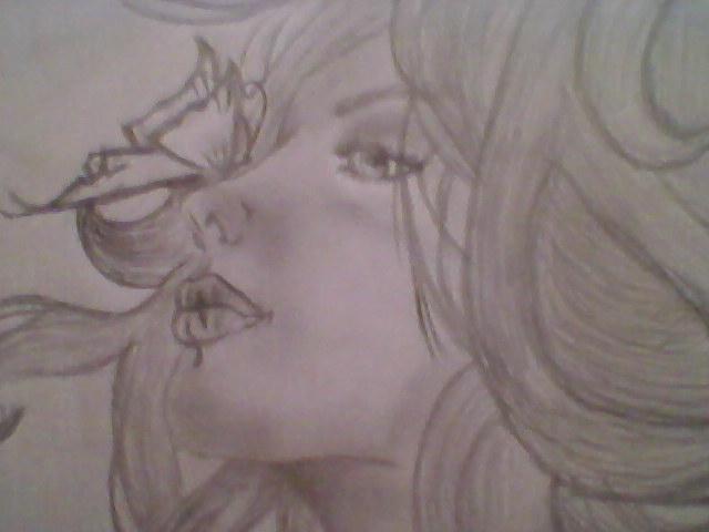 mujer_con_mariposa_es_misma_foto_antes_pero_mejor_calidad_16359.jpg